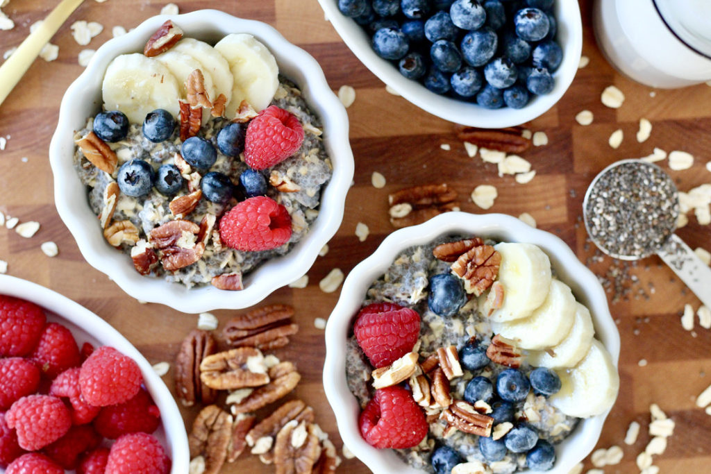 chai seed oatmeal bowls with berries chia seeds and pecans