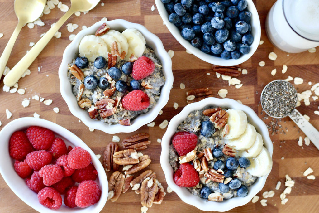chai seed oatmeal bowls with oatmeal toppings and almond milk