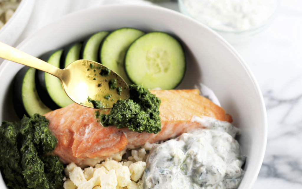 salmon in bowl with cucumbers and pesto how to cook salmon