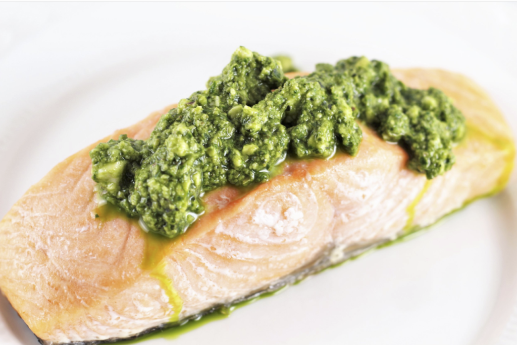 how to cook salmon on white plate with pesto sauce