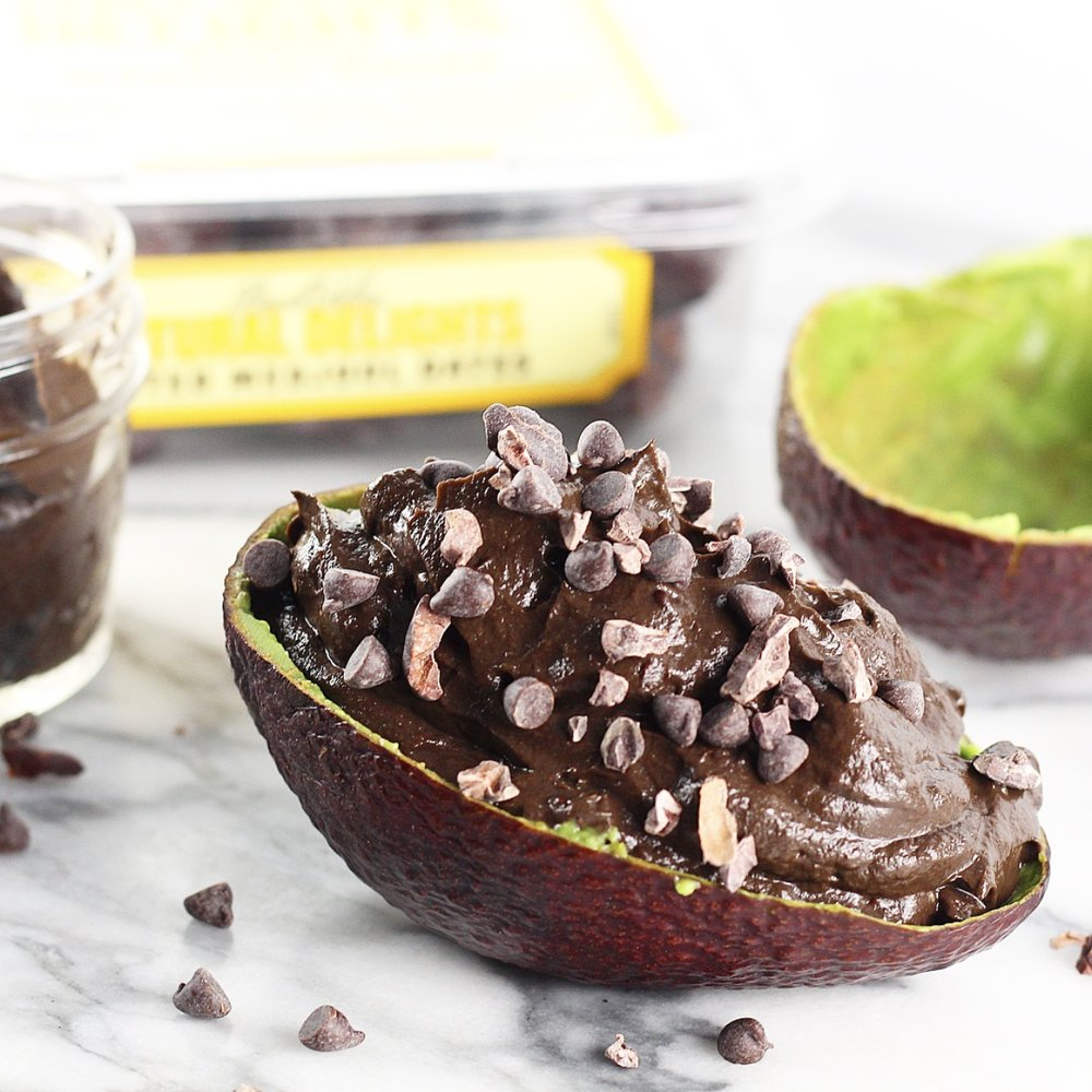 chocolate avocado pudding inside avocado skin with chocolate chips