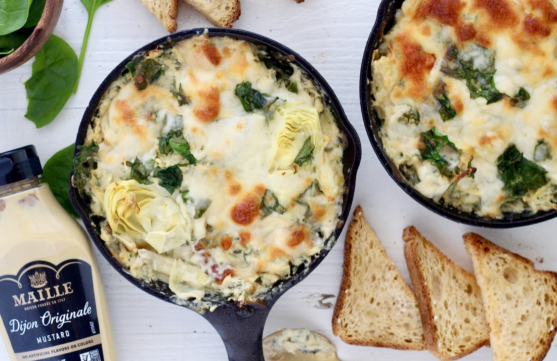 Creamy Dijon Spinach Artichoke Dip in cast iron skillets