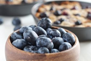 Grain Free Blueberry Lemon Breakfast Cookie Skillet with bowl of blueberries
