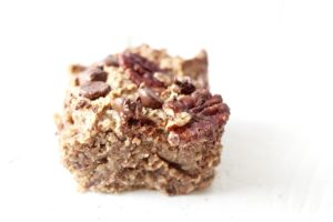 grain free coconut pecan chocolate chip cookie bar with white background