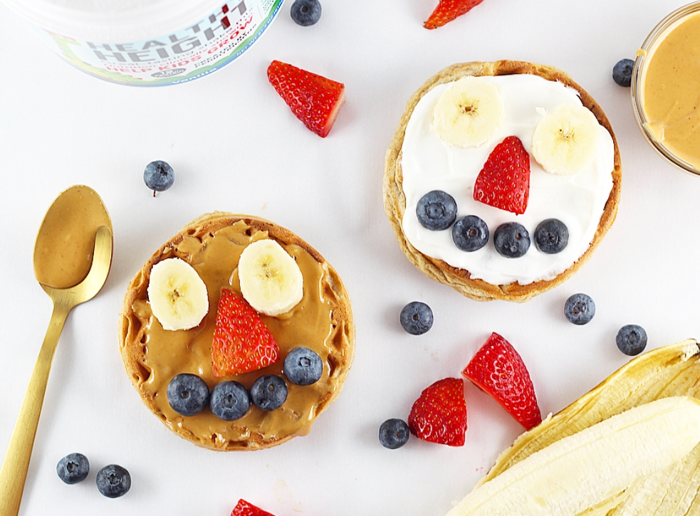 Top your homemade toaster waffles with unsweetened peanut butter or whole milk yogurt and use some fresh produce to make fun faces!
