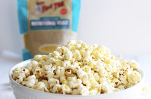 Homemade Zesty Ranch Popcorn Perfect for Movie Night with bag of bobs red mill nutritional yeast