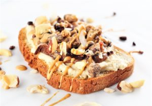 toast topped with hummus, dates, and drizzled with peanut butter