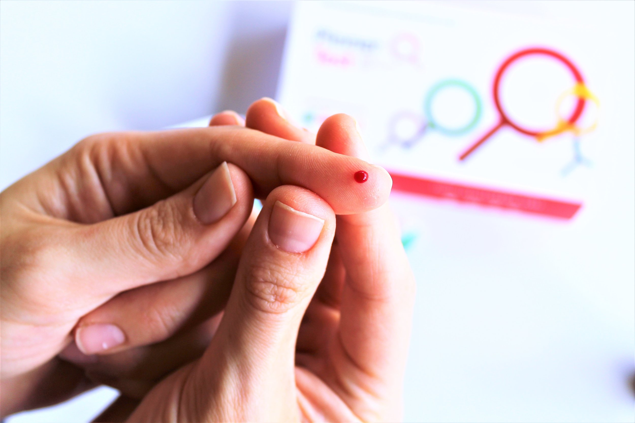 small finger prick with blood for pinner test box kit