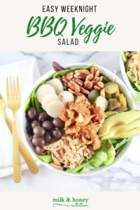 easy weeknight bbq veggie salad aerial view with olives, pecans, pickles, avocado, and lettuce milk and honey nutrition