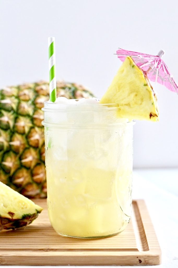 Low Sugar Sparkling Pina Colada with pink umbrella for type 1 diabetes and alcohol