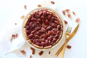 Lower Sugar Pecan Pie on table with pecans