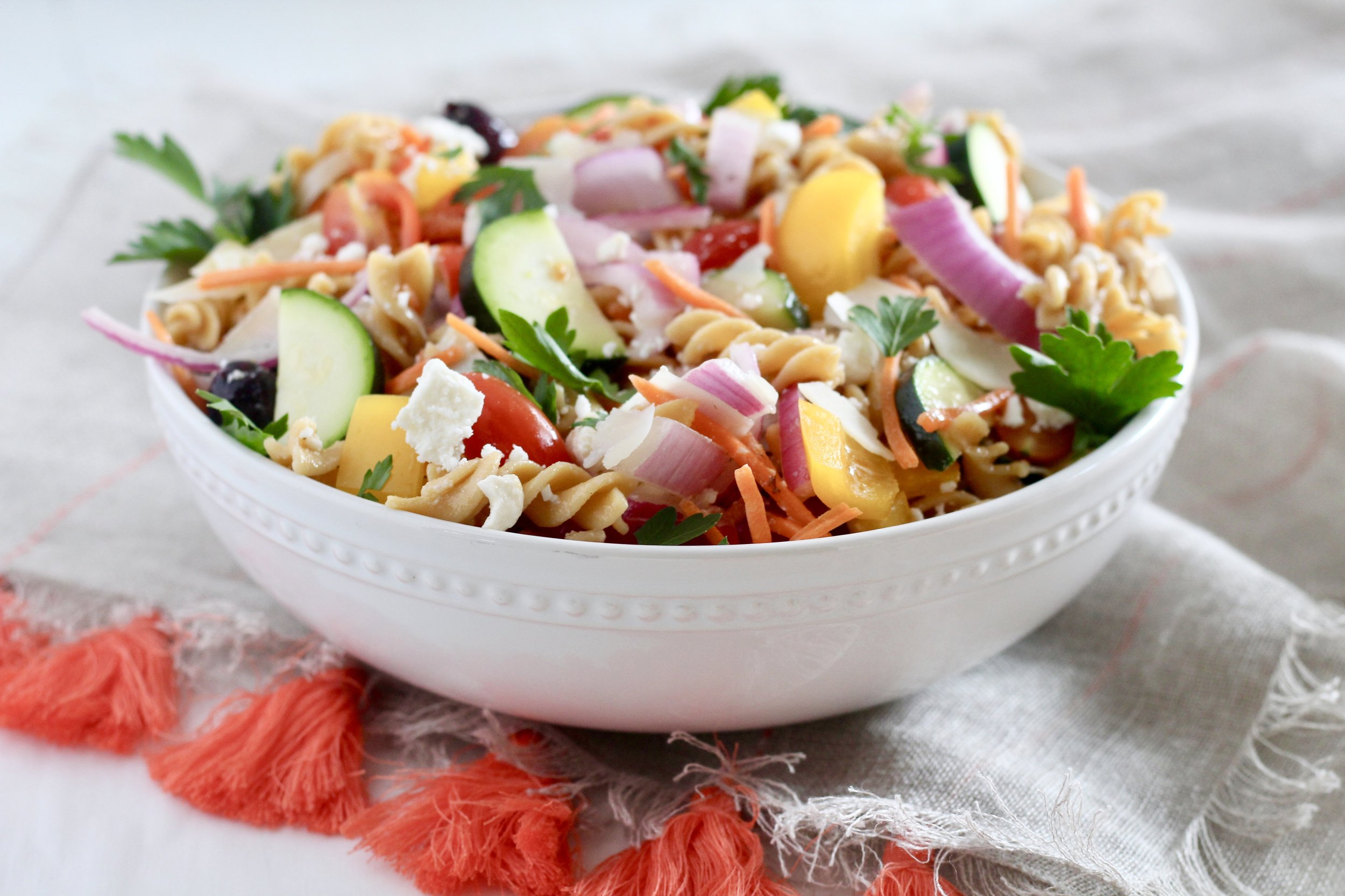 Mediterranean Veggie Pasta Salad in white bowl