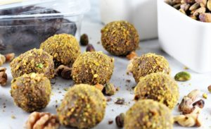 No-Bake Pistachio Walnut Energy Balls on counter with bowl of pistachios