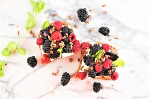 slices of toast with berries and mint toppings