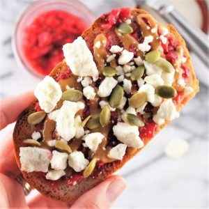 Toast topped with peanut butter, jelly, and feta