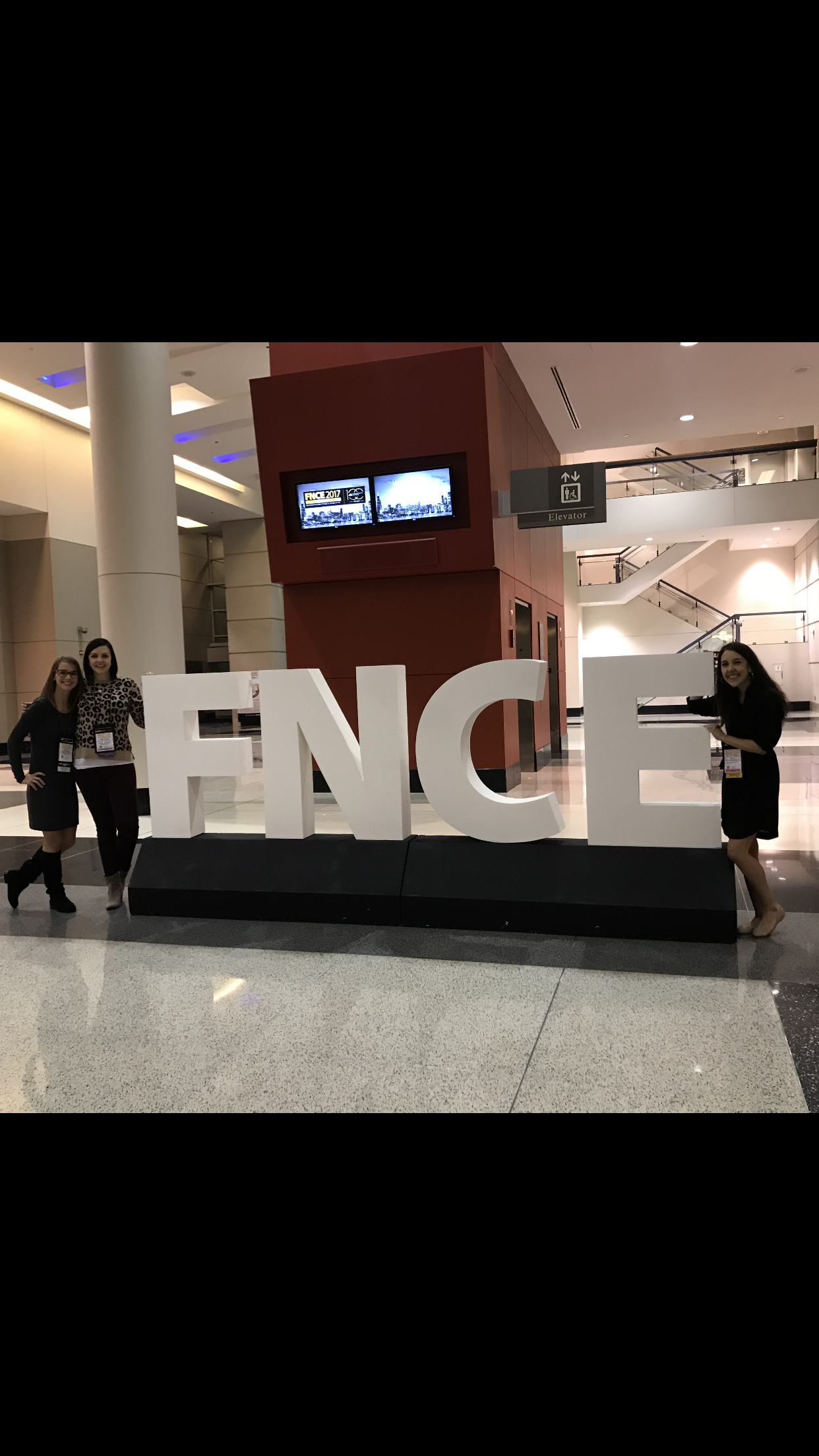 mary ellen phipps with colleagues at fnce in chicago