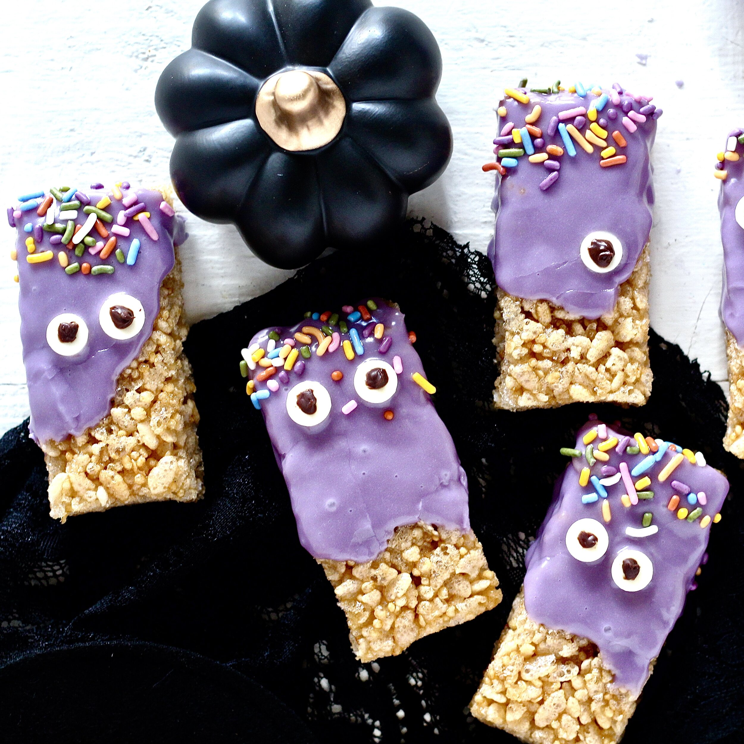 Purple Monster Halloween Treats with black pumpkin