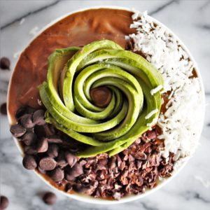 avocado frozen hot chocolate with avocado in the shape of a rose with chocolate chips