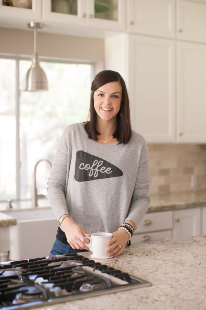 Mary Ellen Phipps dietitian in kitchen with coffee mug