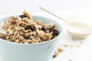 cranberry maple tahini granola in turquoise bowl