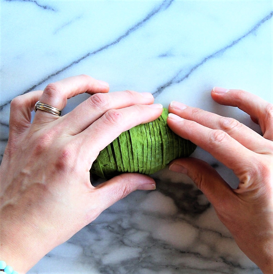 Slowly and gently, starting on your dominant hand side, begin to fan out the slices as shown.