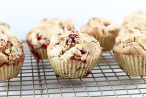 low sugar strawberry muffins on cooling rack