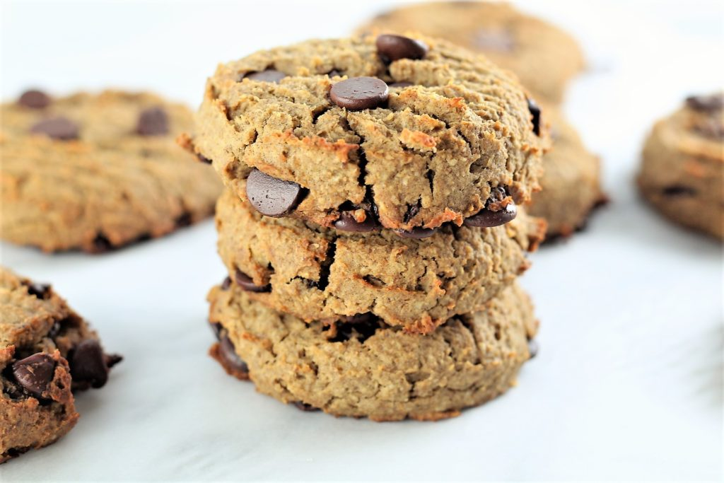 oatmeal chocolate chip high protein cookies 3 stacked on counter