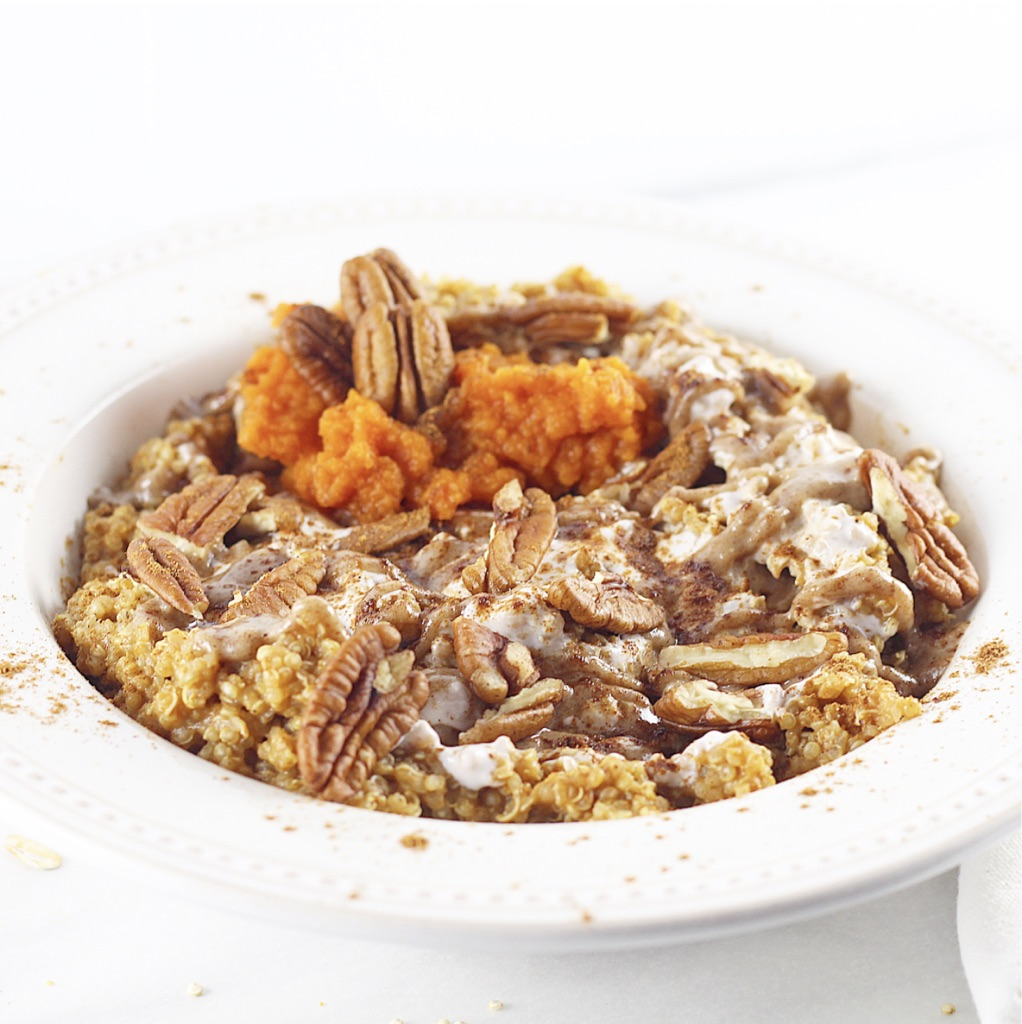 quinoa breakfast bowl with pecans and pumpkin