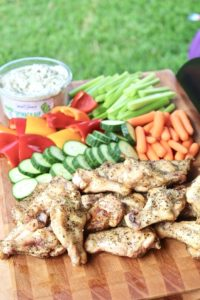 chicken wings and veggies on grill