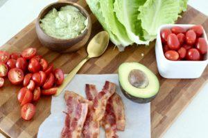 blt lettuce wrap ingredients on wood cutting board