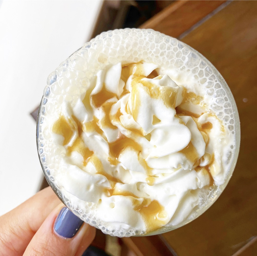 foamy latte with whipped cream