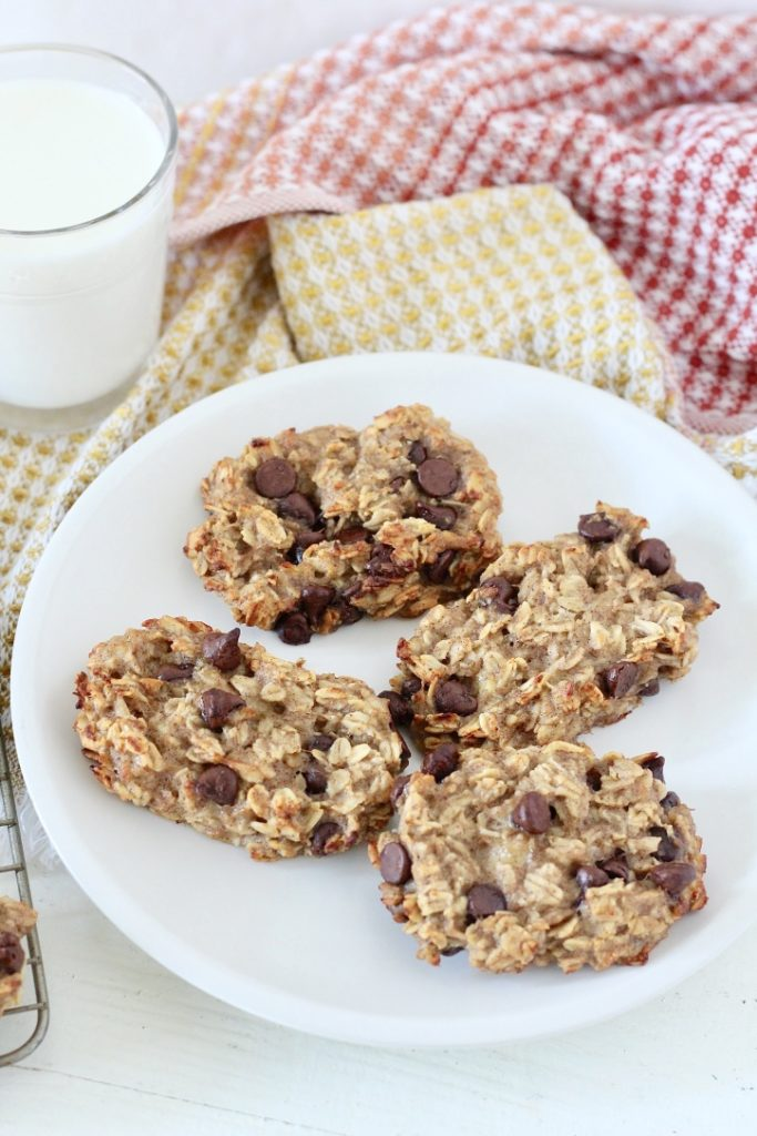 oatmeal chocolate chip bars on white plate with glass of milk
