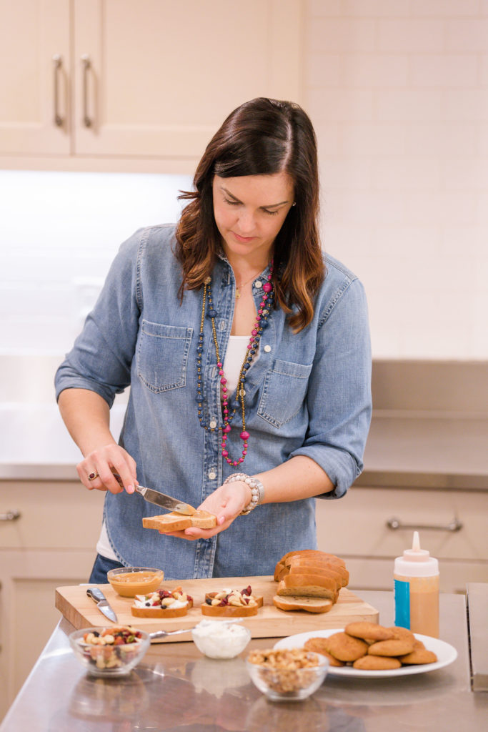 woman with type 1 diabetes making toast in kitchen for blood sugar balance
