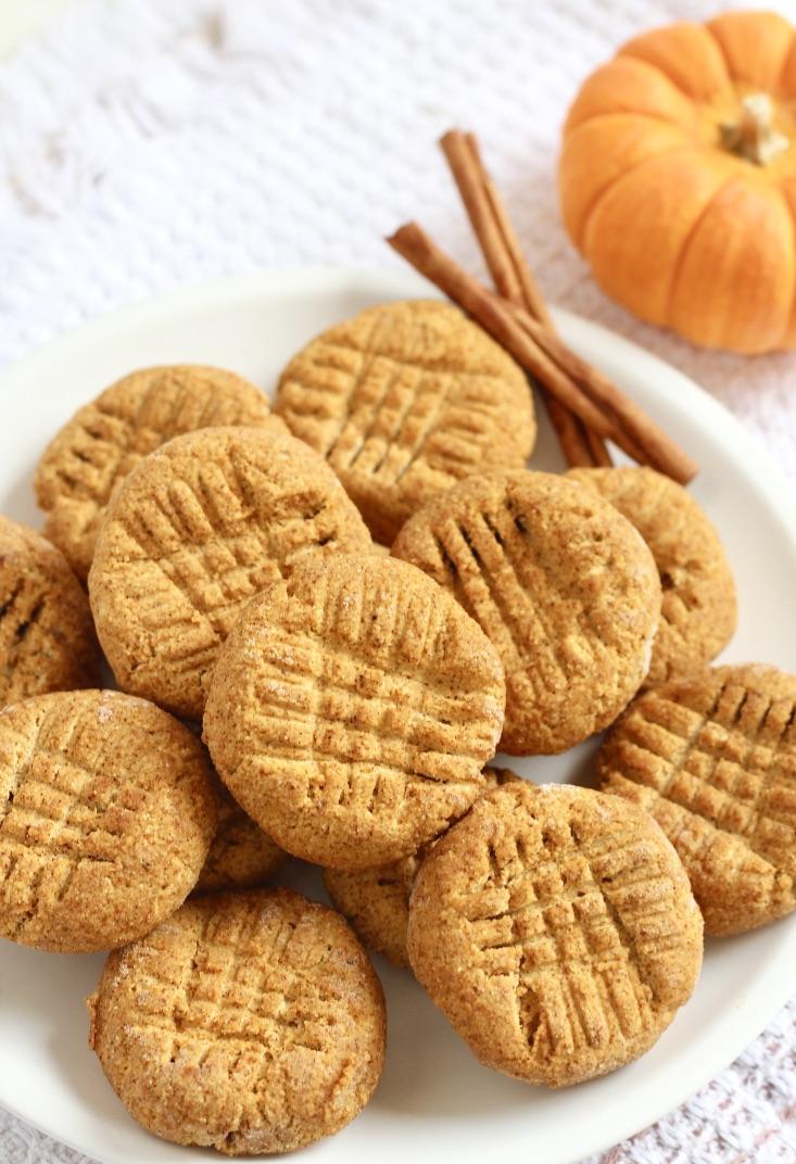 plate of pumpkin cookies with mini pumpkin