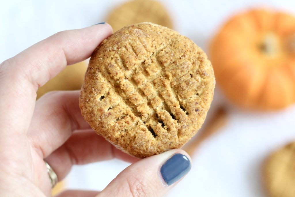 pumpkin cookie with grey gel nail polish