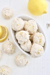 lemon no bake cheesecake bites in white dish with lemon slices