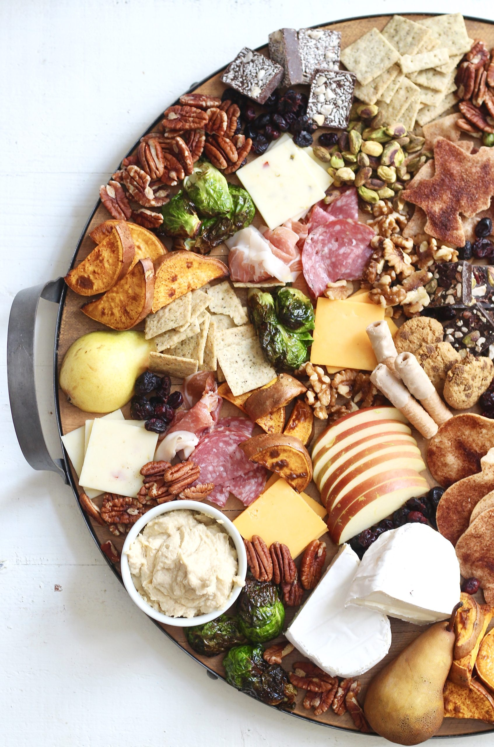 fall charcuterie board on round wood and metal platter