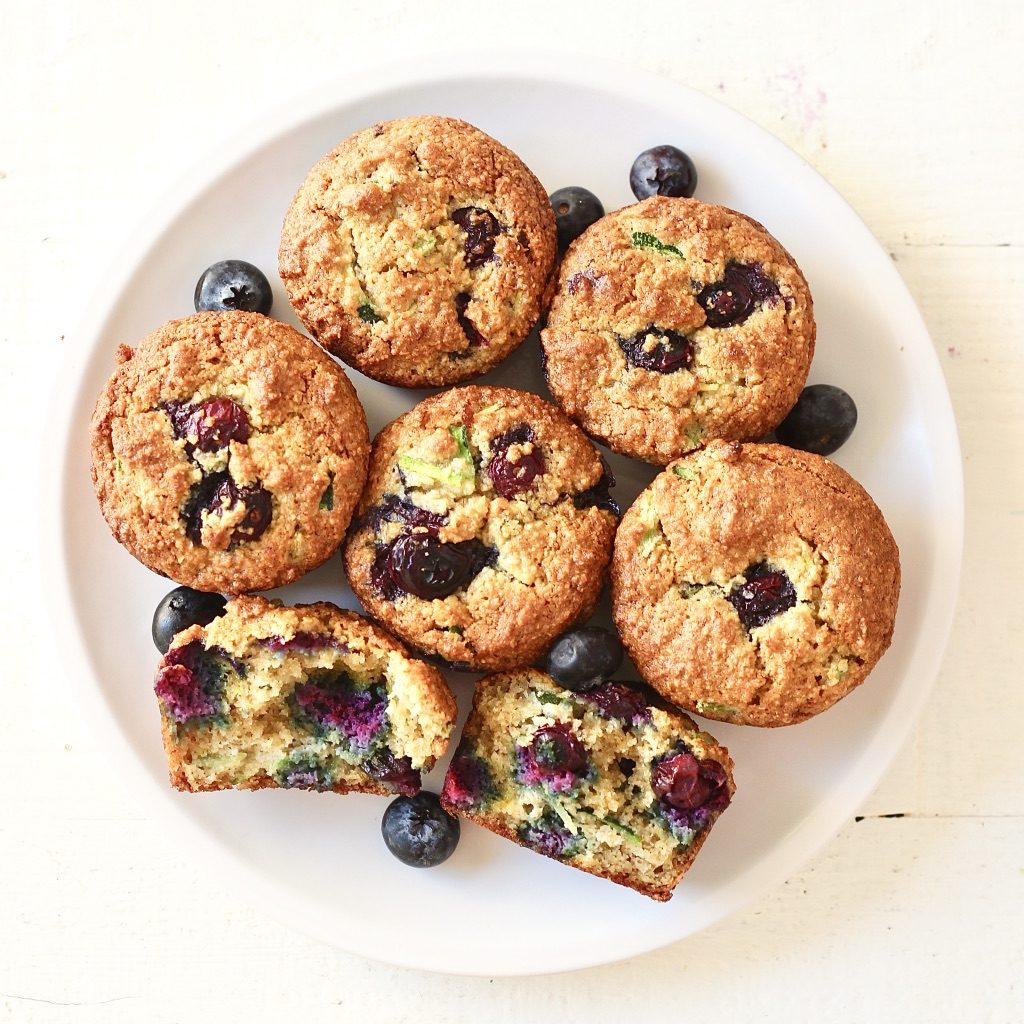blueberry zucchini muffins on white plate