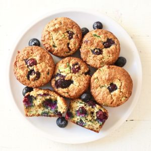 blueberry zucchini muffins on white plate