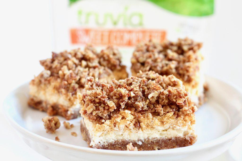 three layered cheesecake bars with trivia