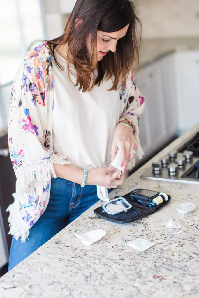 woman with diabetes changing insulin pump infusion set