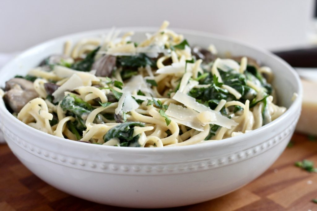 truffle mushroom pasta in white bowl