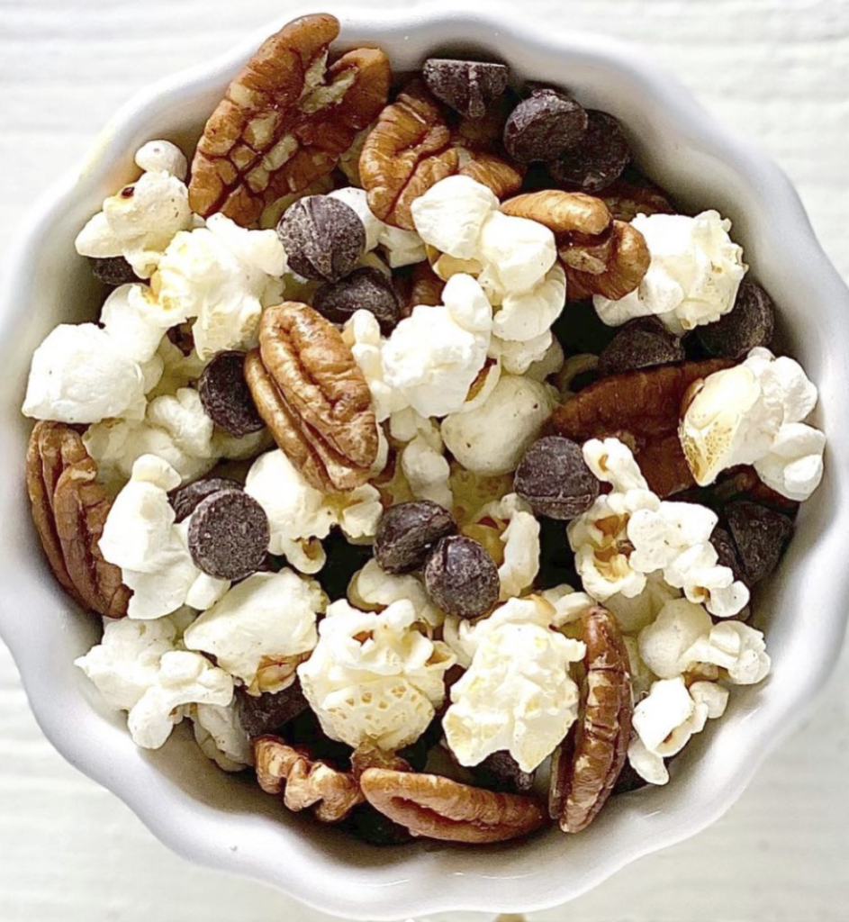 popcorn pecans chocolate chips trail mix in white bowl bedtime snacks for diabetes