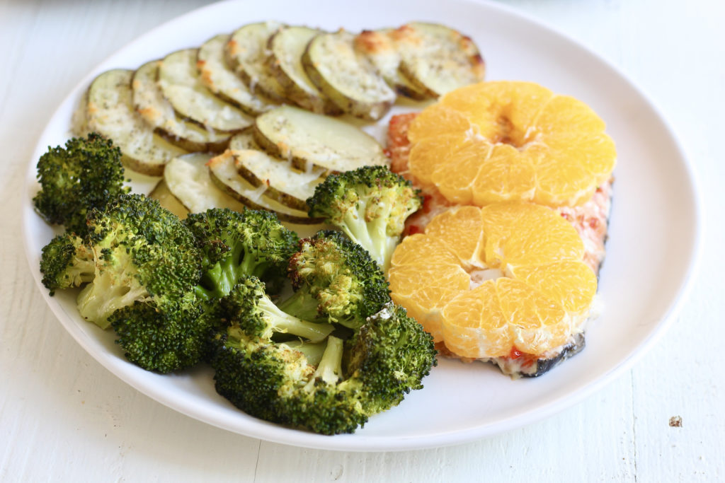 dinner plate with salmon broccoli citrus and potatoes from one pan salmon and veggies