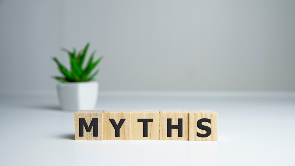 myths with wood block letters and green plant