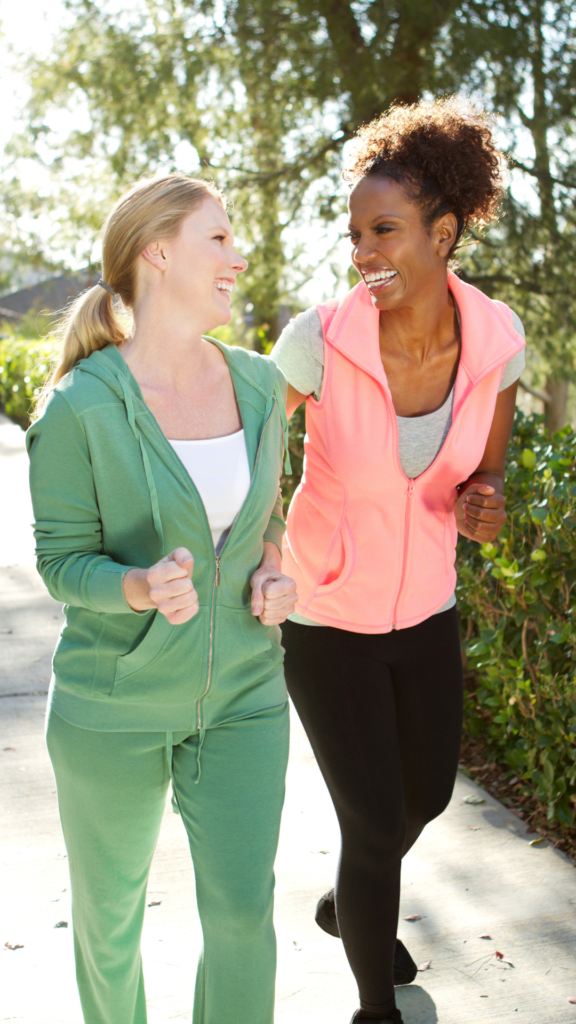 two women walking how to lower a1c naturally