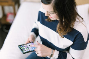 woman using diabetes apps on phone