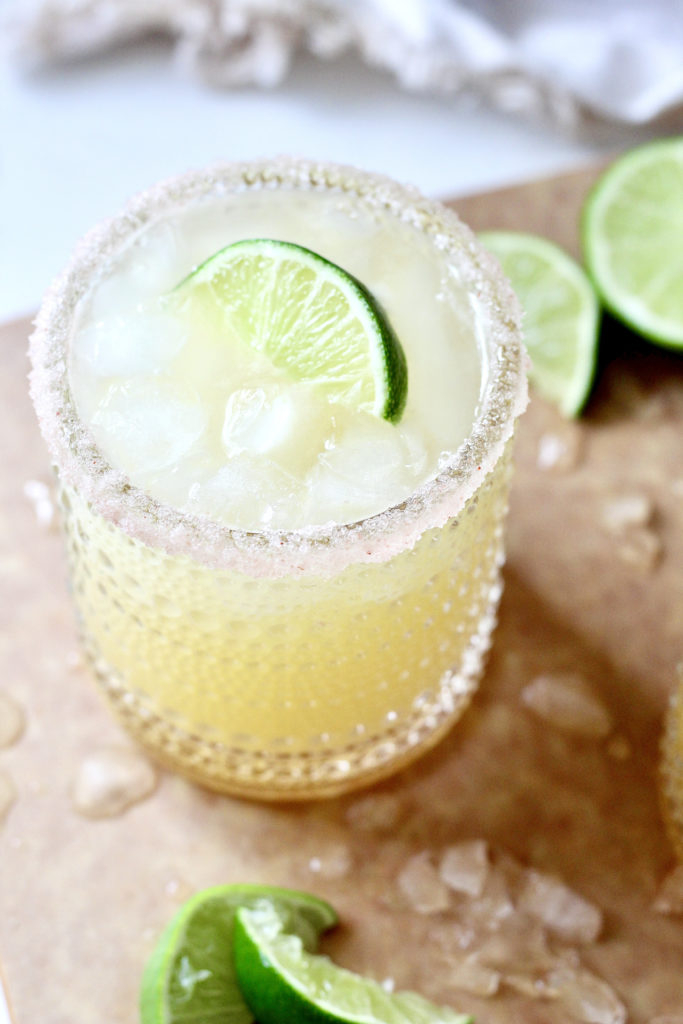 skinny margarita in 8oz glass with imes