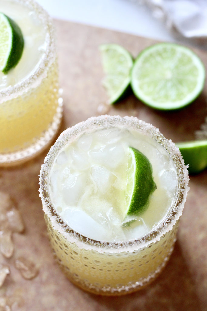 flat lay of skinny margarita with limes