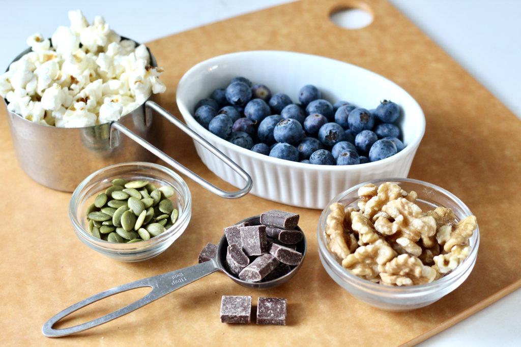 homemade trail mix  ingredients popcorn walnut blueberries pumpkin seeds chocolate